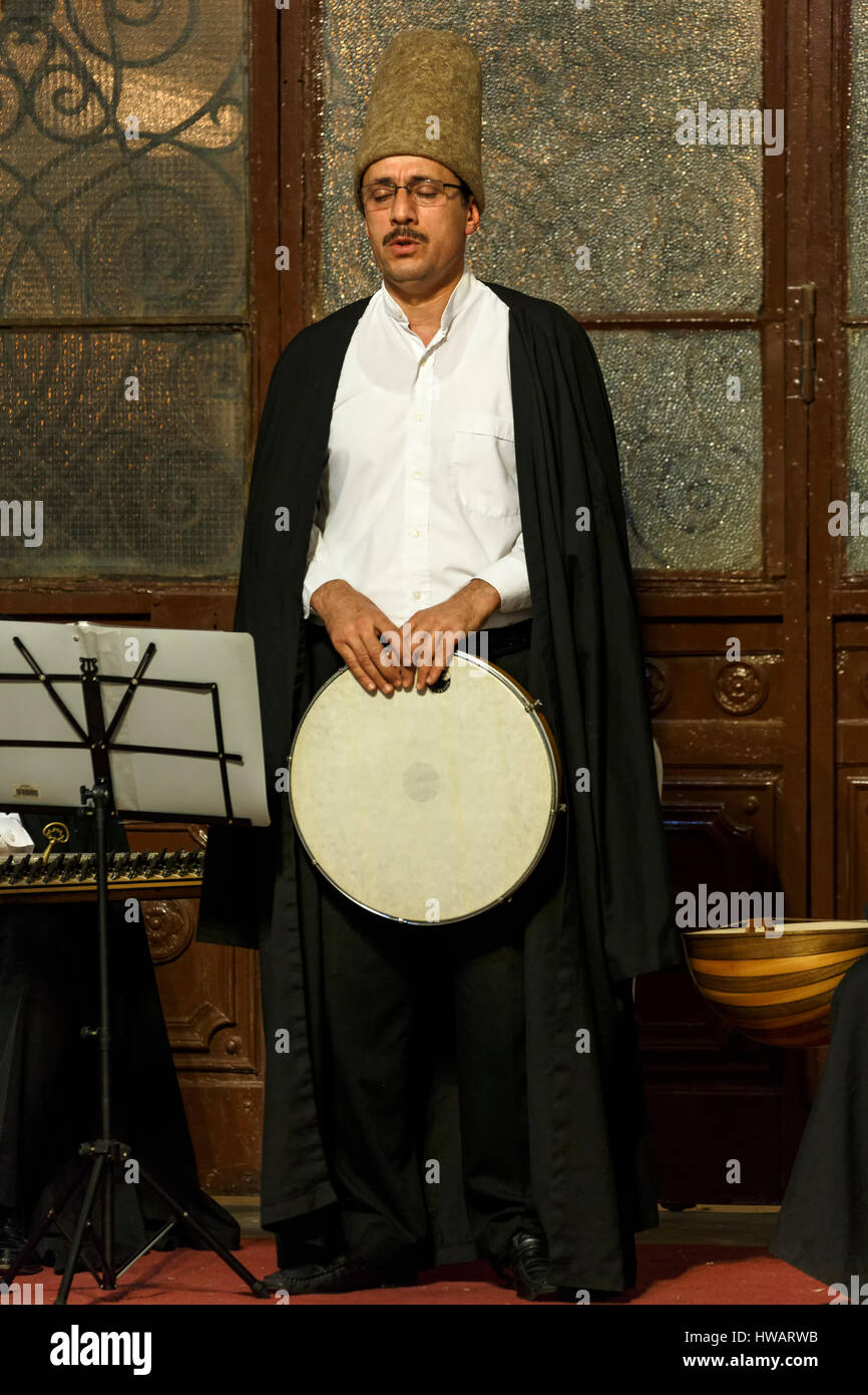 Drummer singing, whirling dervishes ceremony, Sirkeci Train Station, Istanbul, Turkey - Stock Image