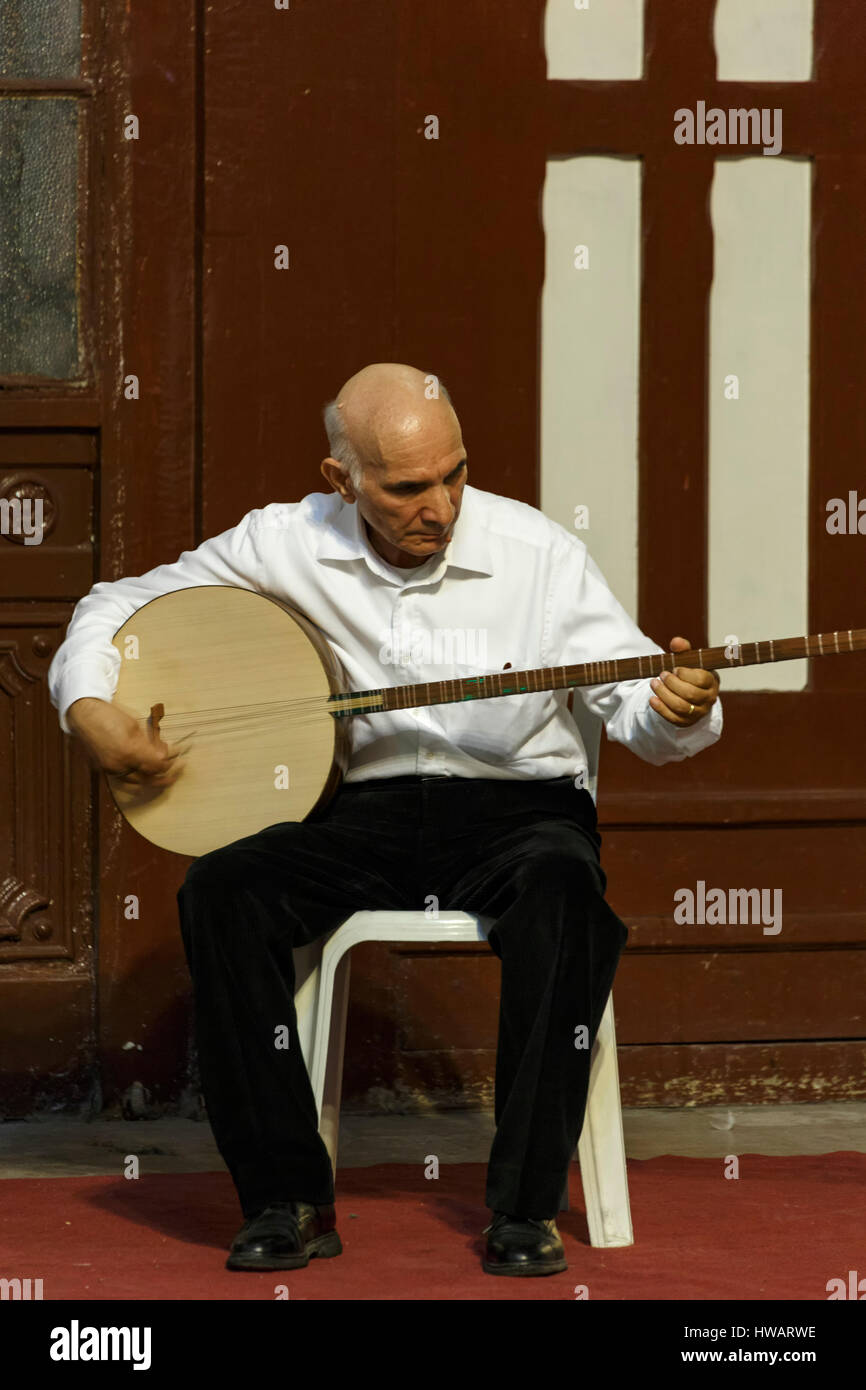Tambur-mandolin player, whirling dervishes ceremony, Sirkeci Train Station, Istanbul, Turkey - Stock Image