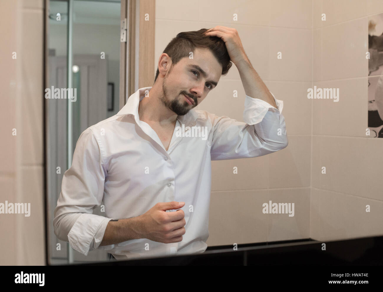 Handsome man care about hair Stock Photo