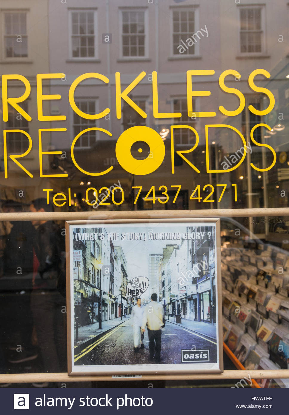 Oasis' What's the Story Morning Glory album cover in the shop window of Reckless Records in Soho, London, - Stock Image