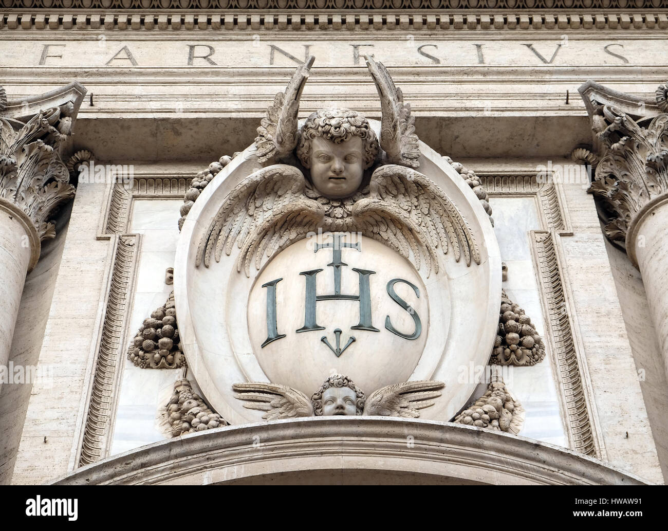 Christogram IHS, facade of the Church of the Gesu, mother church of the Society of Jesus, Rome, ItalyStock Photo