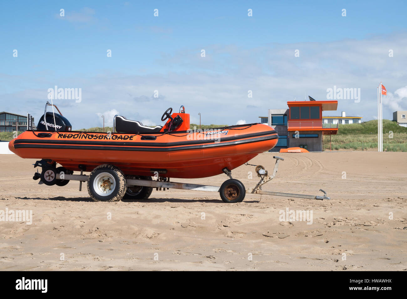 Speedboat of the Dutch lifeguard association at the beach of Katwijk in front of the guardhouse Stock Photo