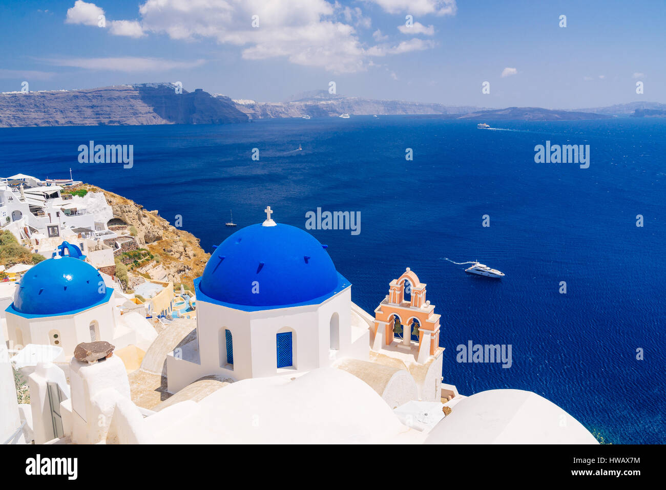 Wolrd famous blue dome churches in Oia, Santorini, Greece - Stock Image