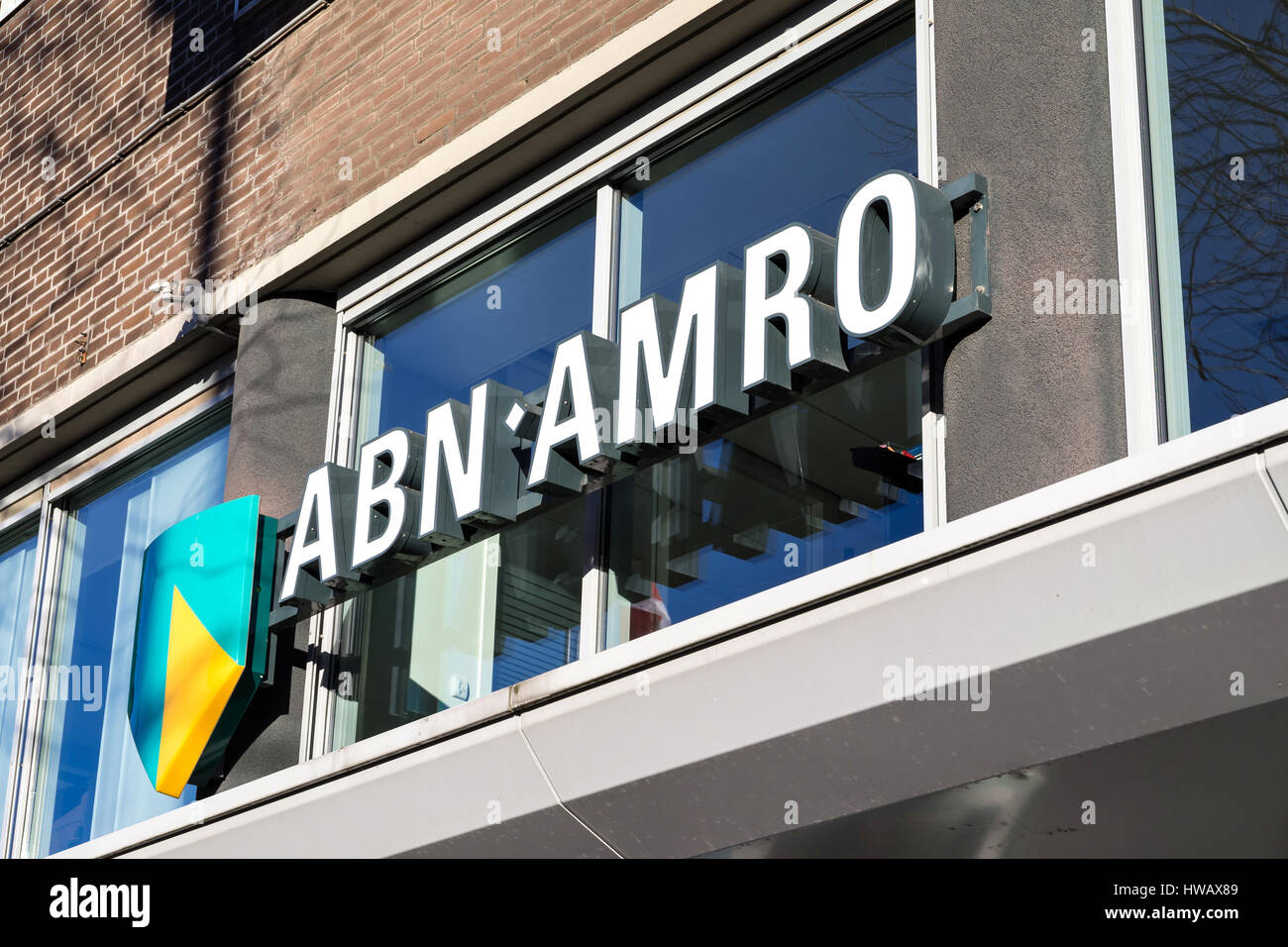 entrance of an ABN AMRO branch. ABN AMRO is the third-largest bank in the Netherlands. - Stock Image