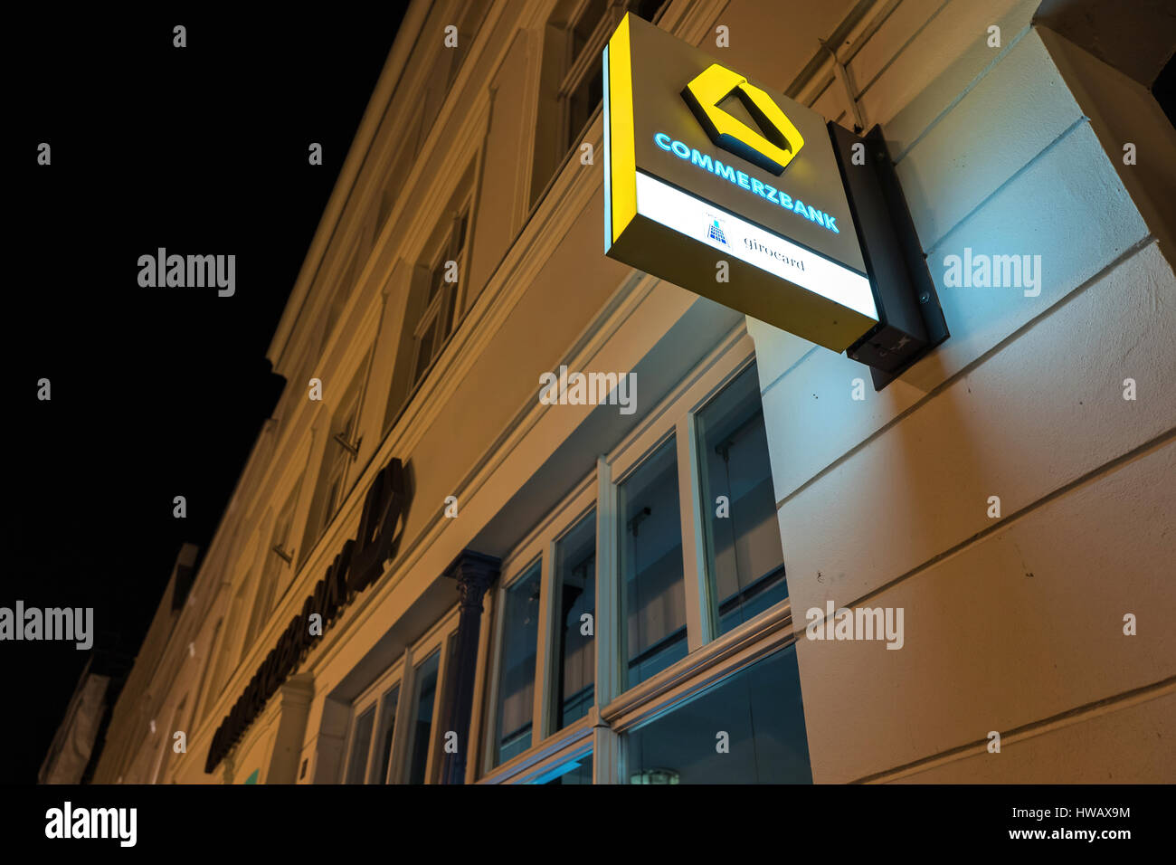 Commerzbank branch at night - Stock Image