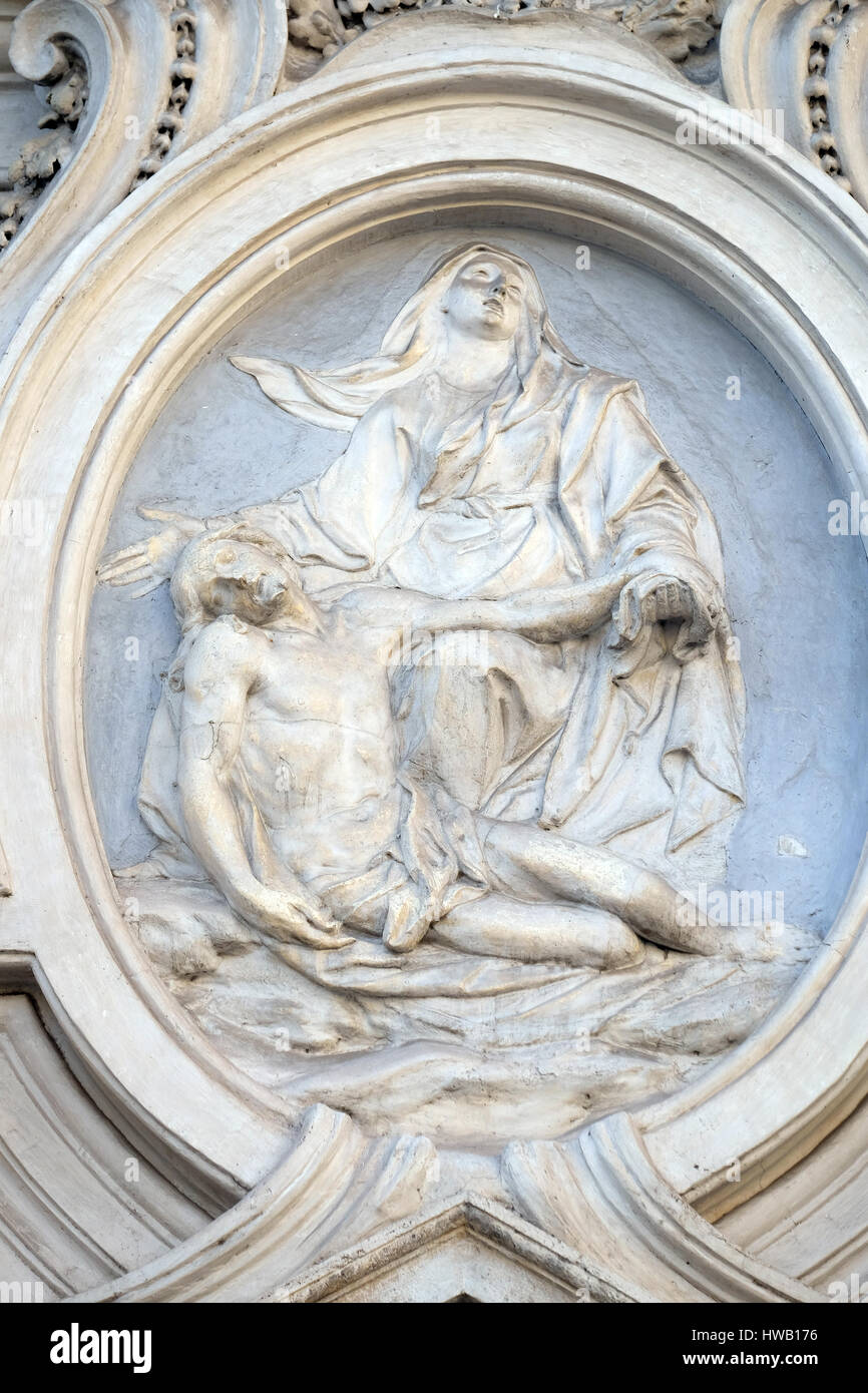Our Lady of Sorrows, bass relief on the facade of Sant Andrea de Urso church in Rome, Italy  on September 02, 2016. Stock Photo