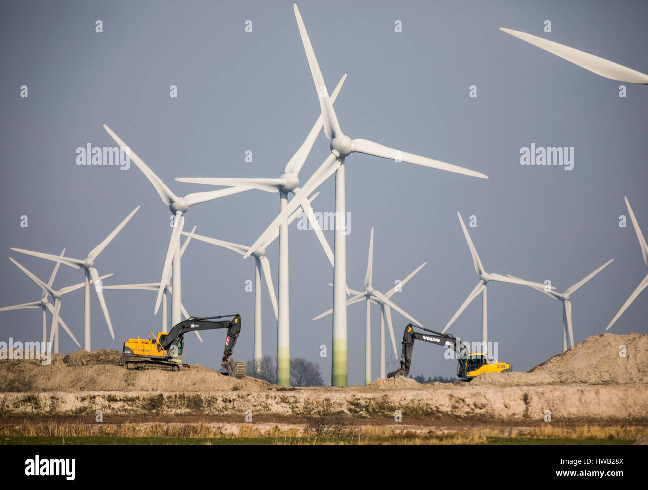 Huge wind energy power plant in northern Germany, east Frisia, North Sea coast, construction, - Stock Image