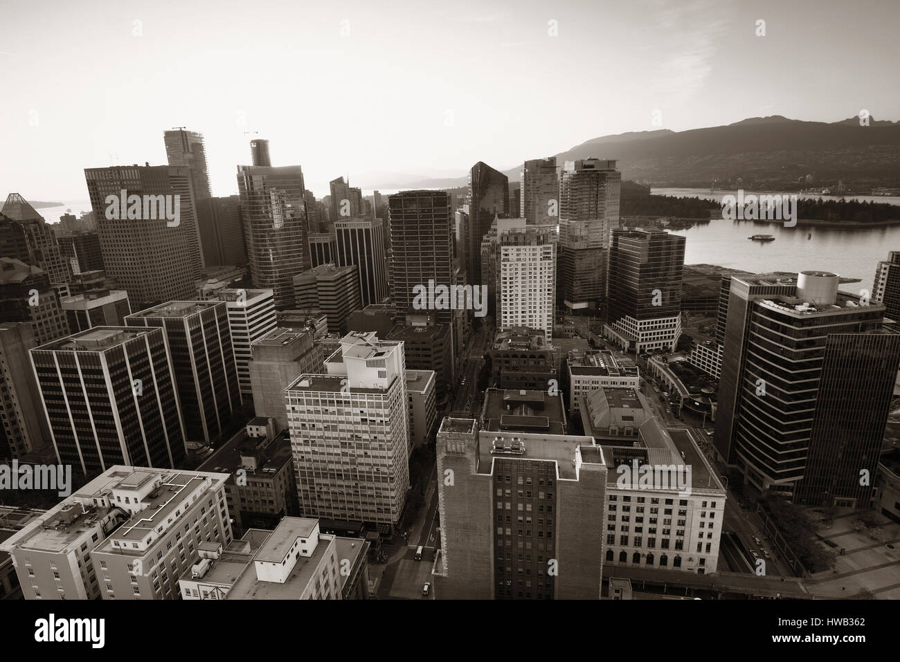 Vancouver rooftop view with urban architectures at sunset. - Stock Image