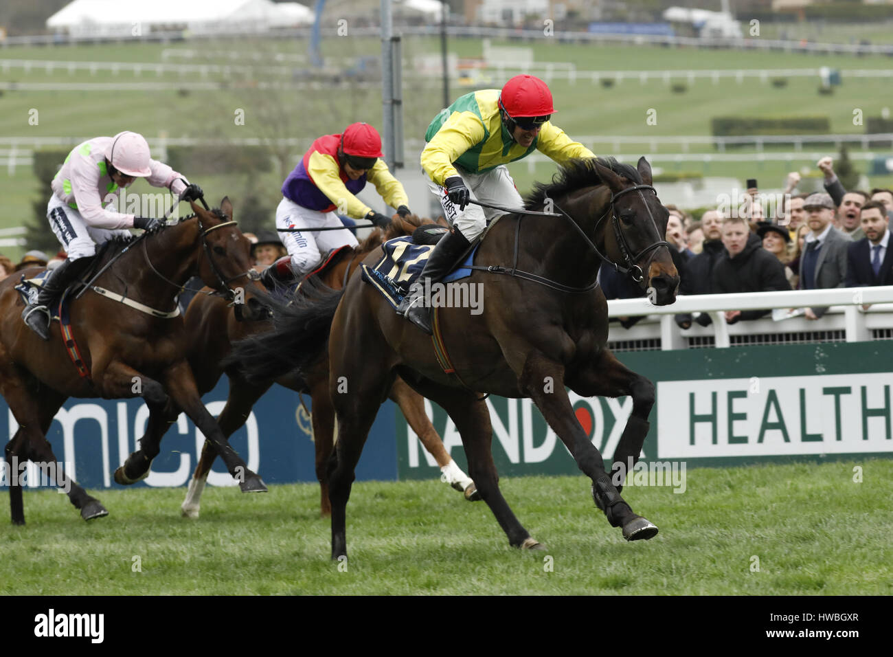 17.03.2017 - Cheltenham; Sizing John (yellow-green) ridden by Robbie Power wins the Timico Cheltenham Gold Cup Chase (Grade 1) at Cheltenham-Racecourse/Great Britain. Credit: Lajos-Eric Balogh/turfstock.com Stock Photo