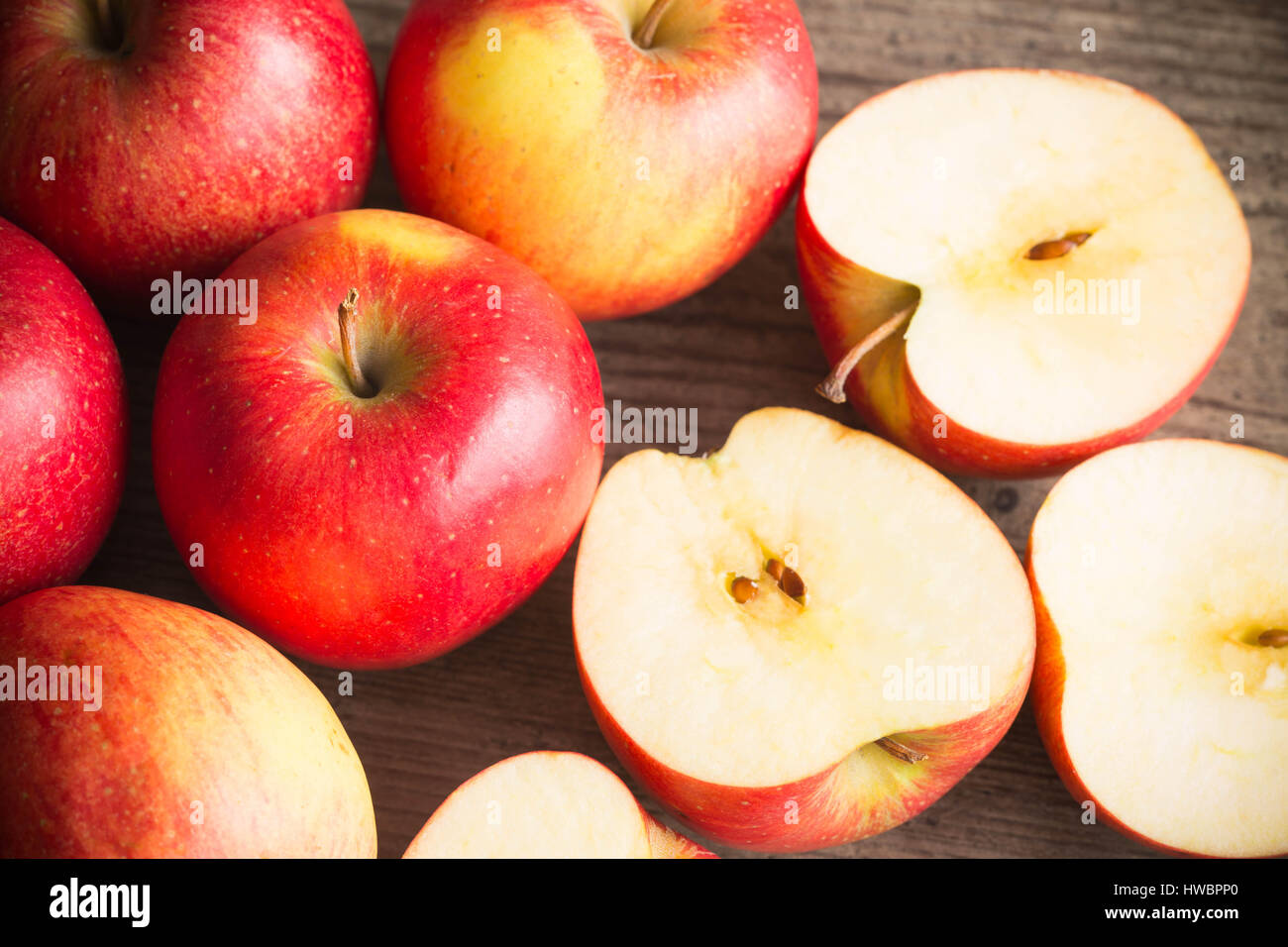 Juicy apple whole and cut apples on a table - Stock Image
