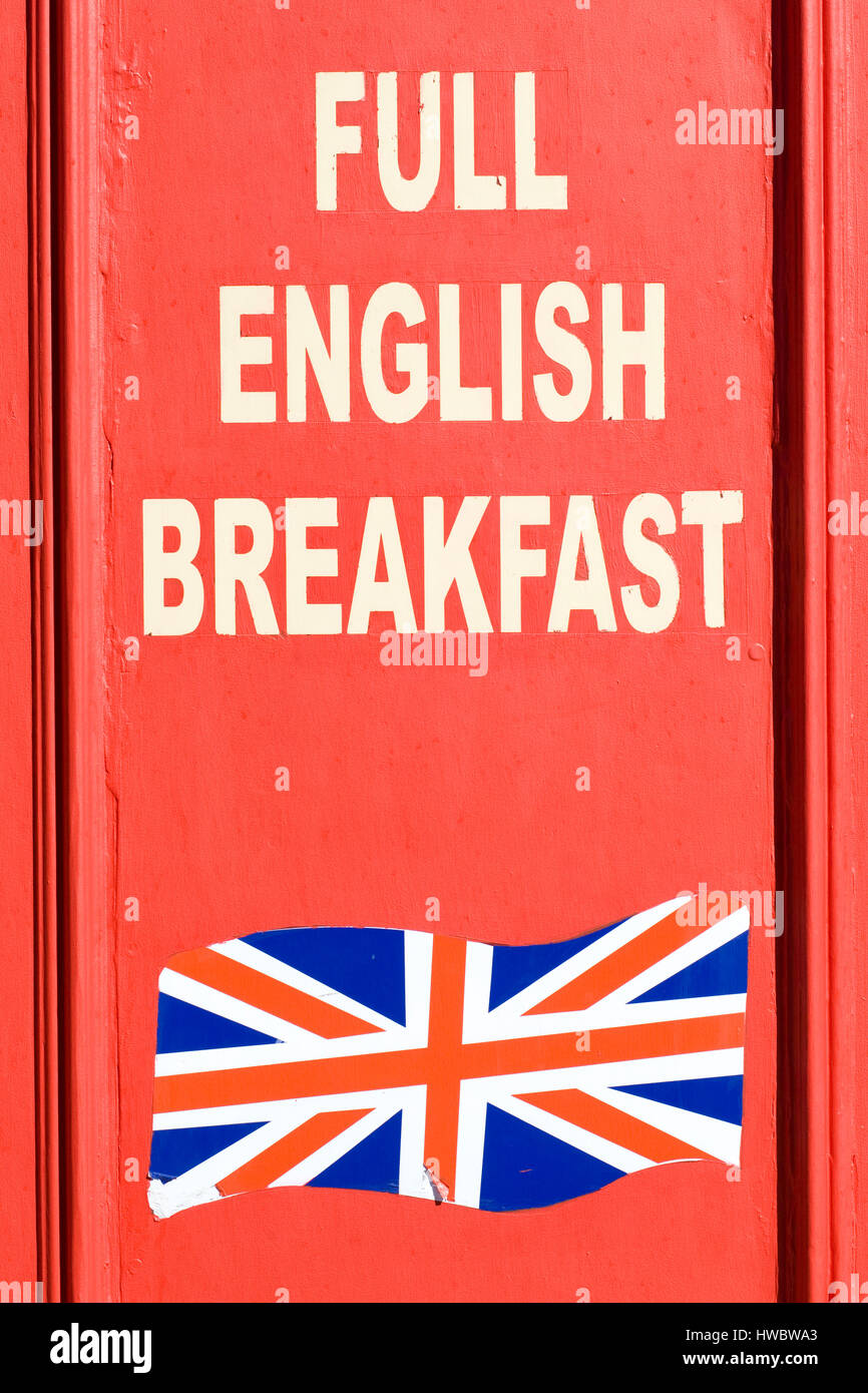 Full English Breakfast Advertised On Wooden Board Stock Photo