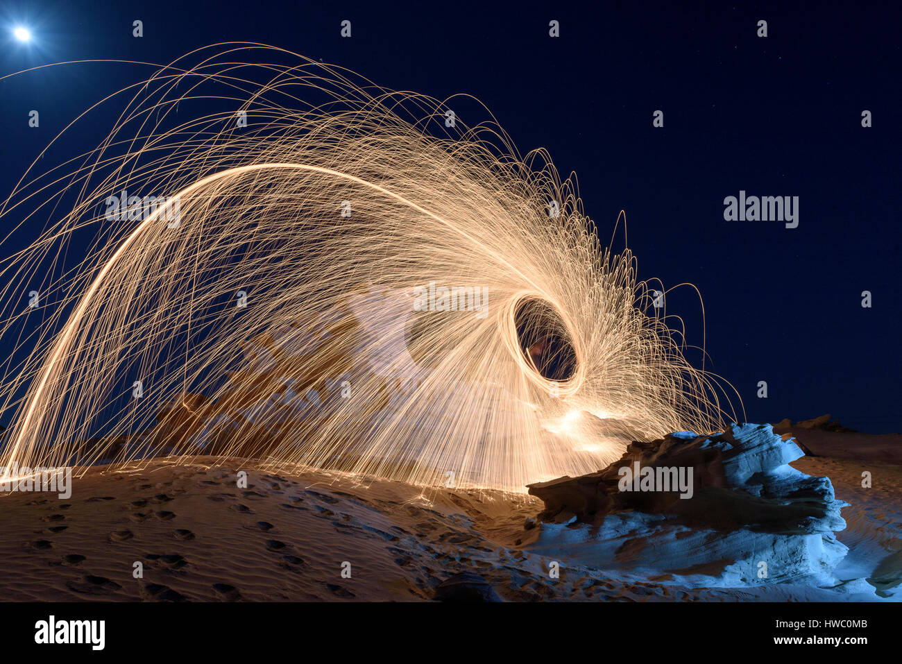 Burning Steel Wool spinning. Showers of glowing sparks from spinning steel wool Stock Photo
