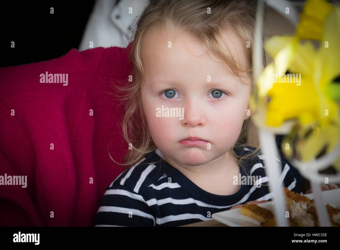 Child Girl Upset Tearful Pout Pouting Direct Gaze - Stock Image
