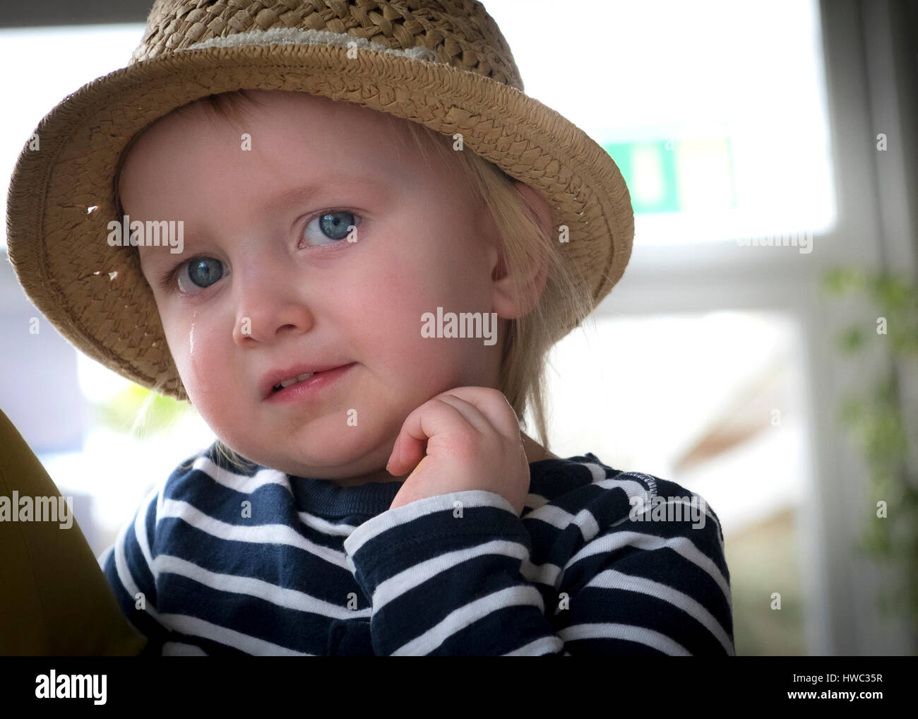 Toddler Child Girl Female Hat Tears Stock Photo