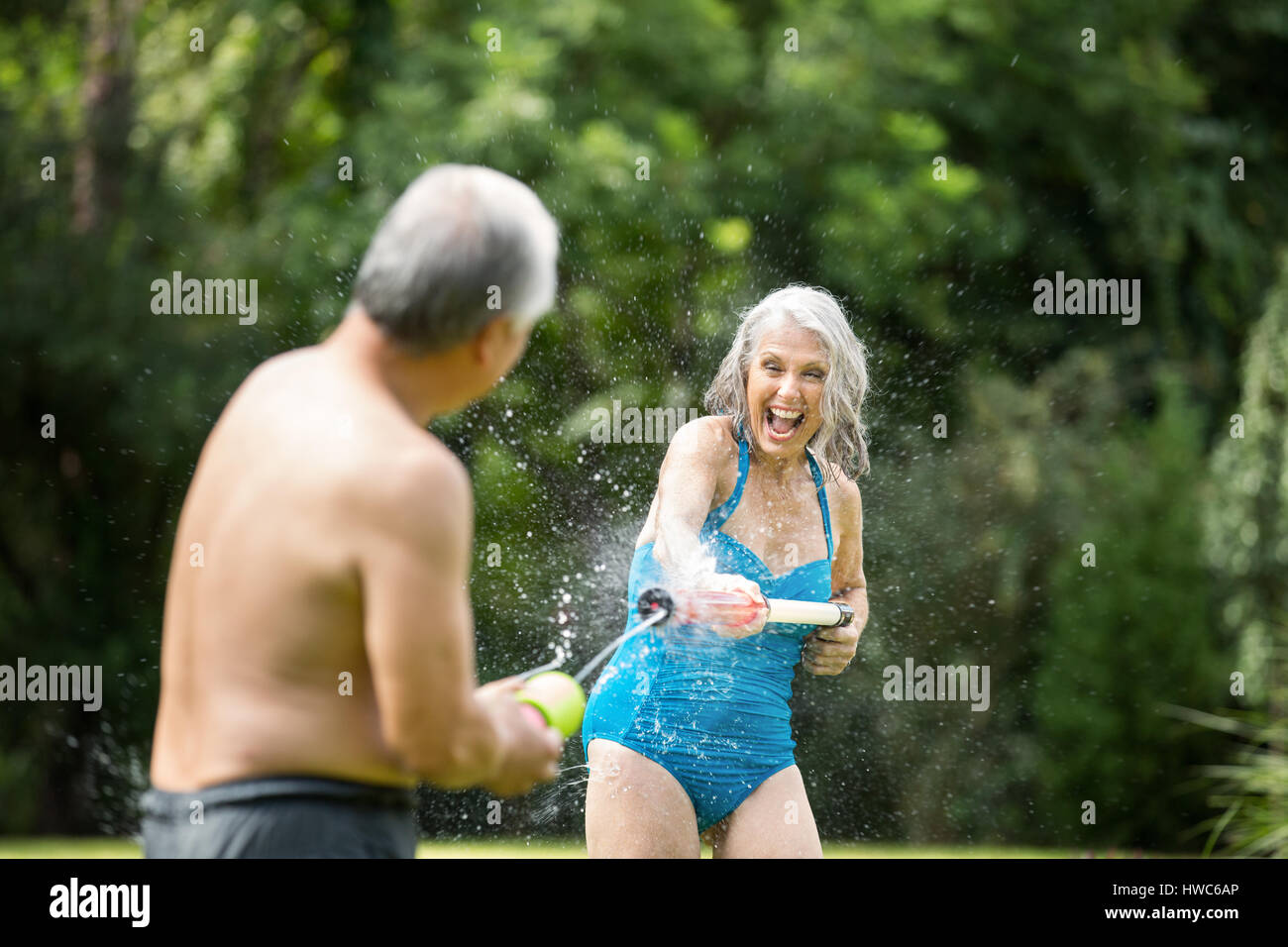 Seniors playing with pool toys - Stock Image