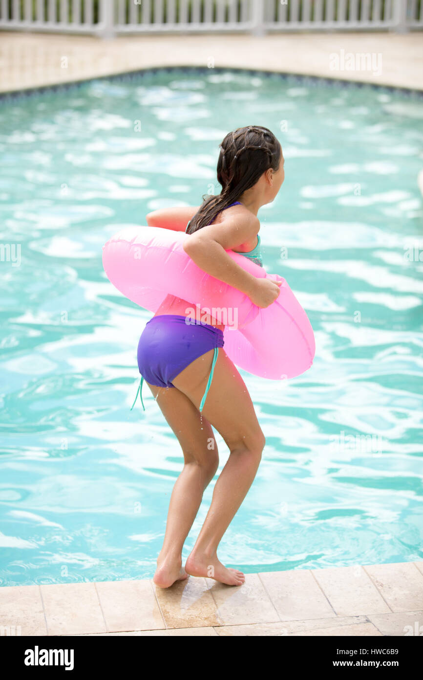 Girl by the pool - Stock Image