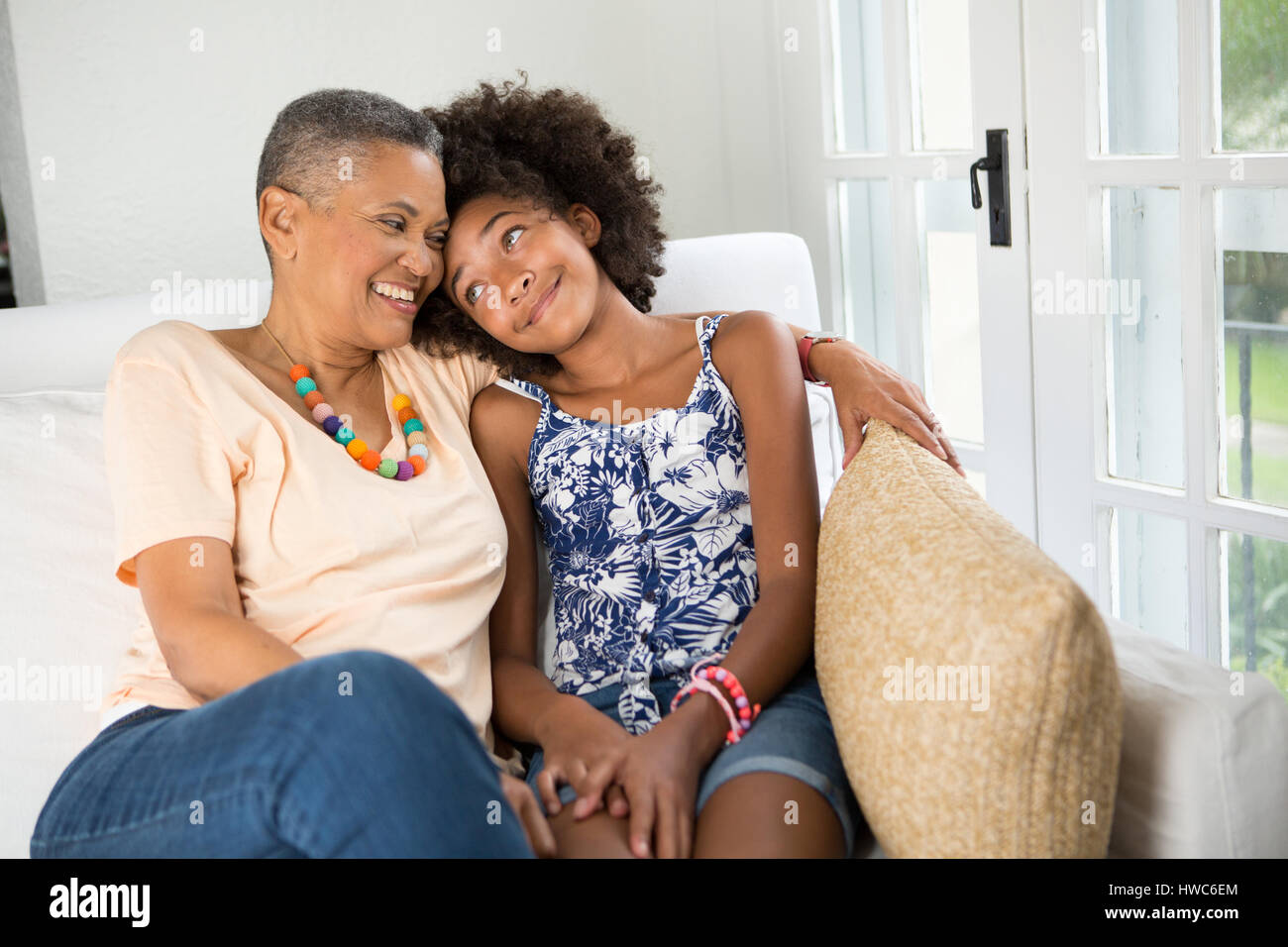 Girl spends quality time with her grandmother - Stock Image