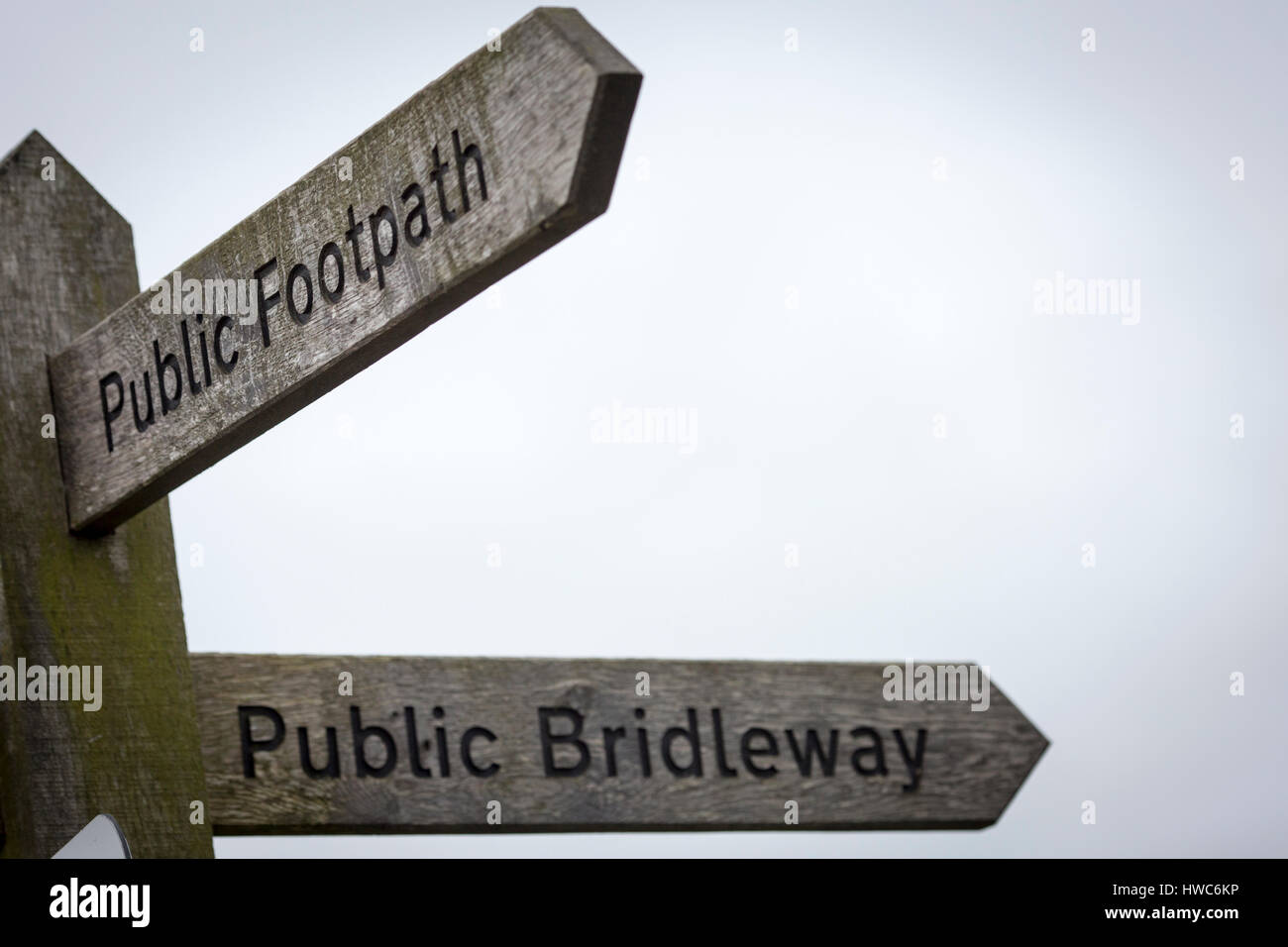Public bridleway and footpath sign in England - Stock Image