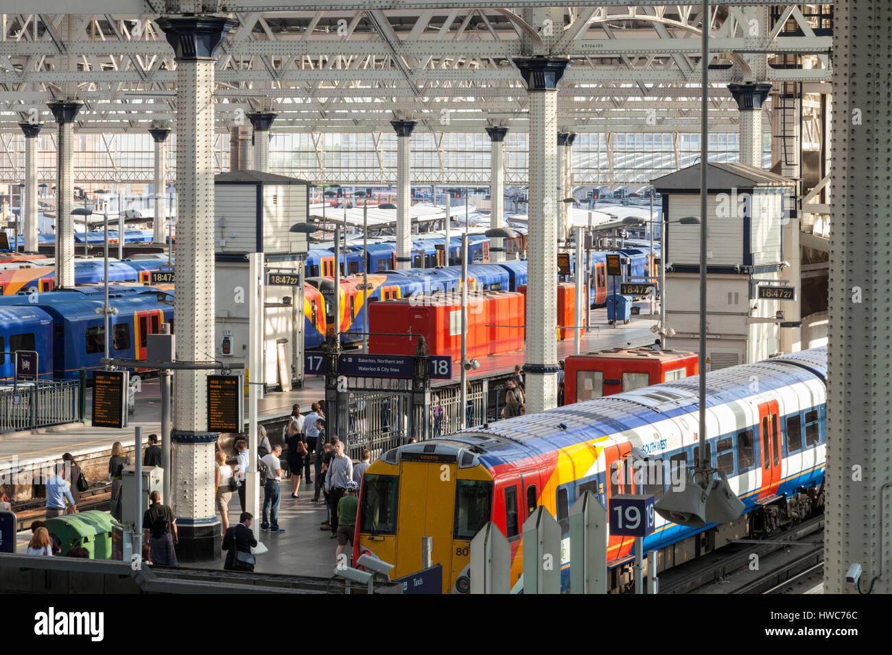 Passengers and trains at Waterloo Railway Station, London, England, UK - Stock Image