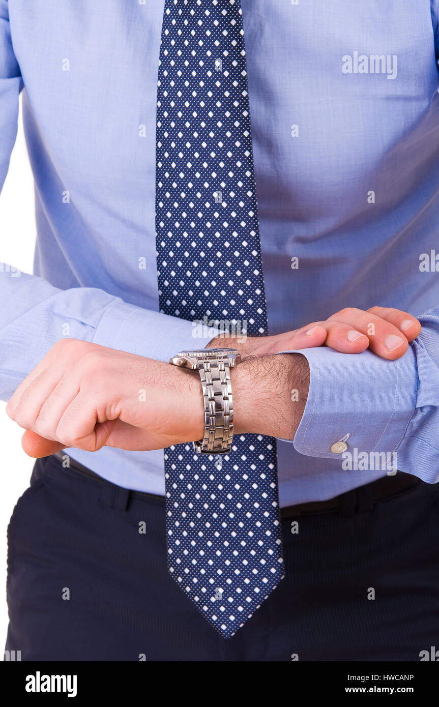 Businessman checking time on his wristwatch. - Stock Image