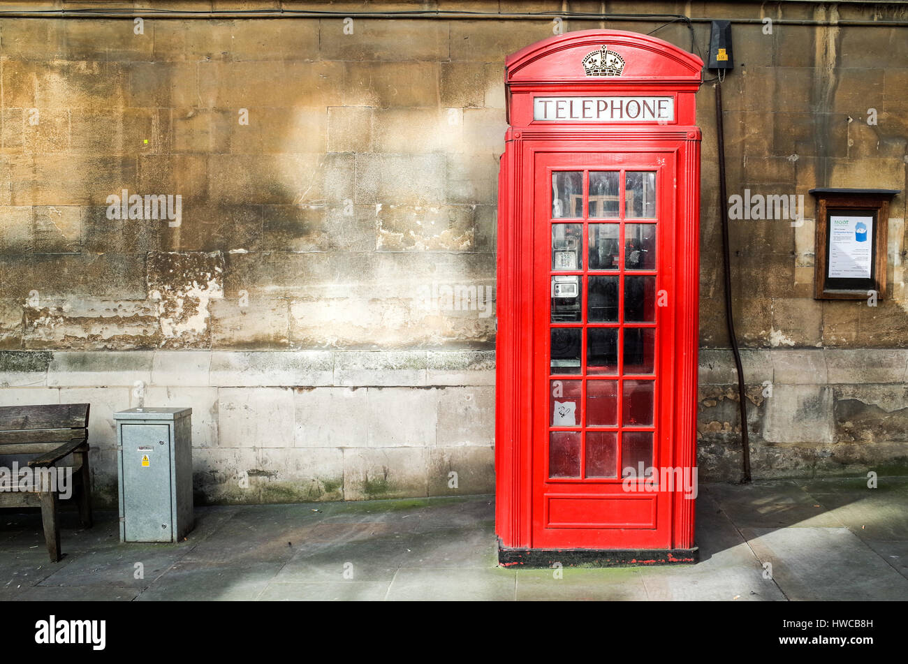 A classic red phone kiosk in London's financial district - Stock Image