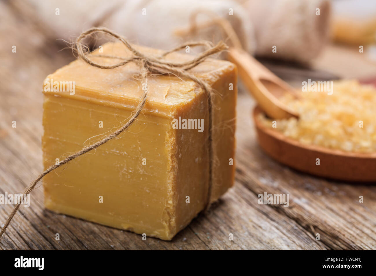 Natural handmade soap bar on wooden background - Stock Image