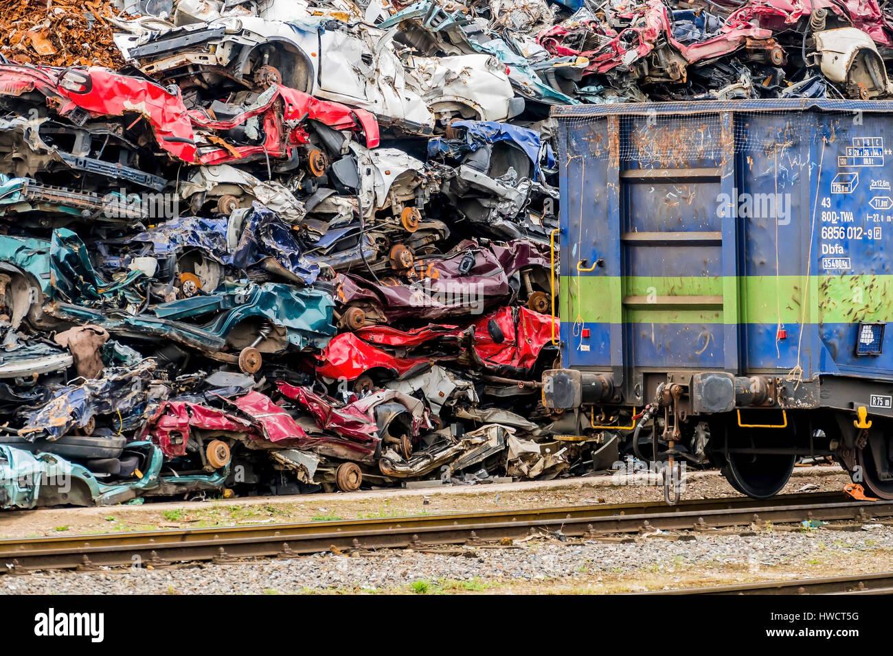 Old cars were scrapped in a scrap metal press. Scrapping premium for ...