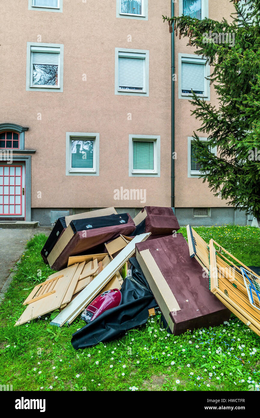 After a move in a new flat the old pieces of furniture wait as a bulky refuse for the garbage disposal., Nach einem Stock Photo