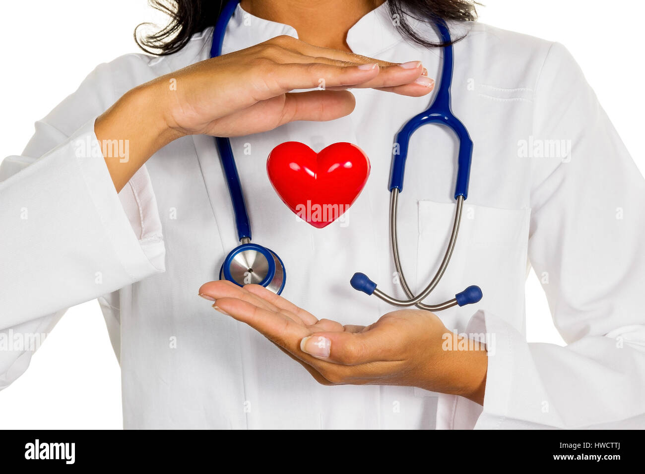 A young doctor (internist) holds a heart symbolically in the hand., Eine junge Ärztin (Internistin) hält - Stock Image