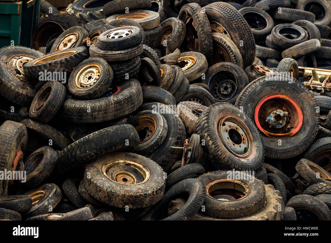 Old tyres on a scrap yard., Alte Autoreifen auf einem Schrottplatz. Stock Photo
