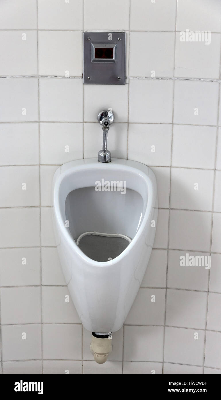 Urinal in a toilet for men. Man's toilet, Urinal in einer Toilette für Herren. Männertoilette - Stock Image