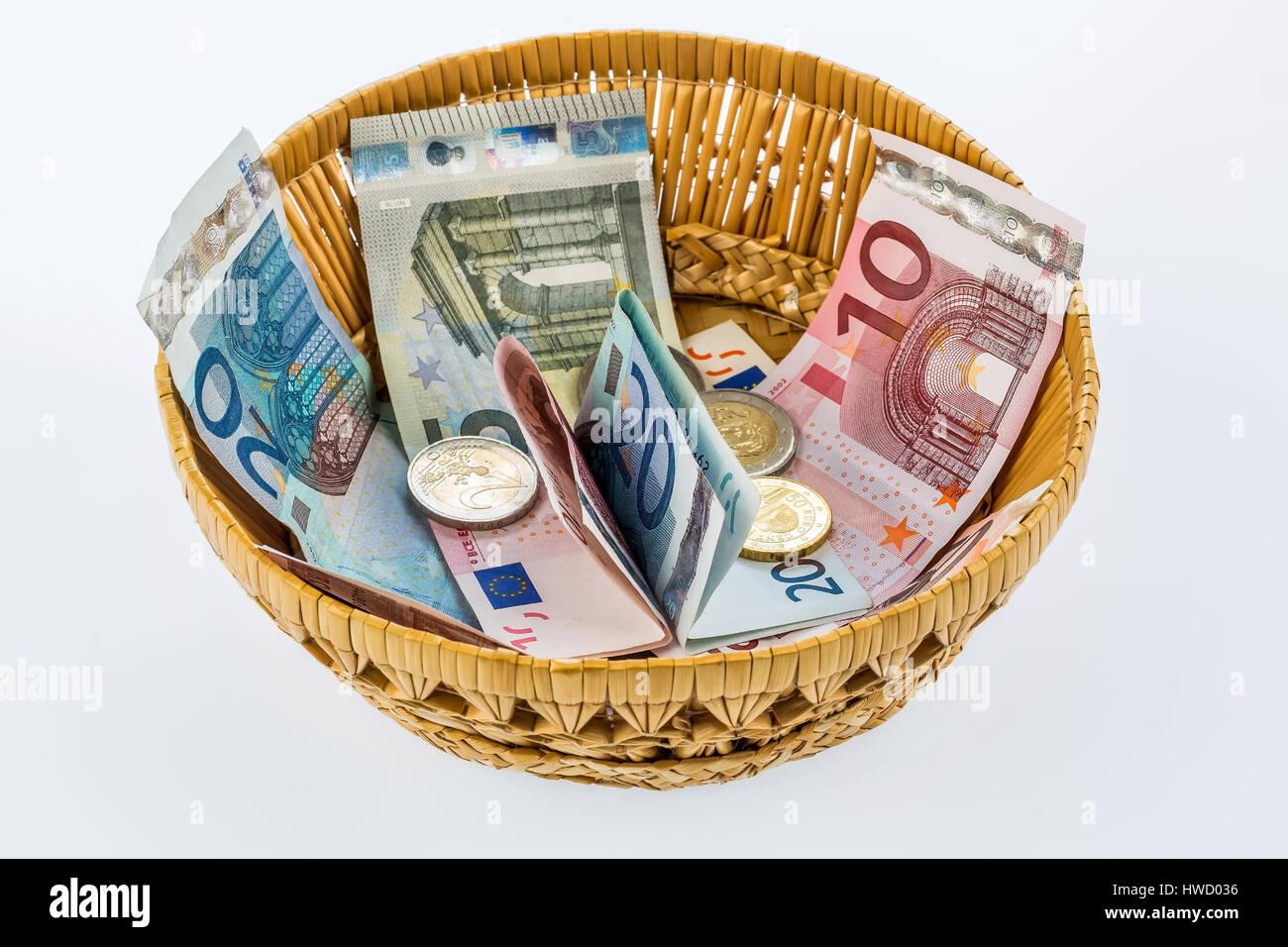 A basket with money for donations and tips, Ein Korb mit Geld für Spenden und Trinkgelder - Stock Image
