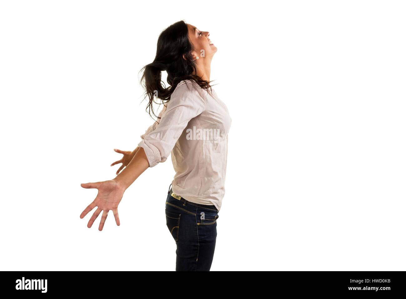 A young woman deeply breathes deeply and genius? t her life, Eine junge Frau atmet tief durch und genie?t ihr Leben Stock Photo