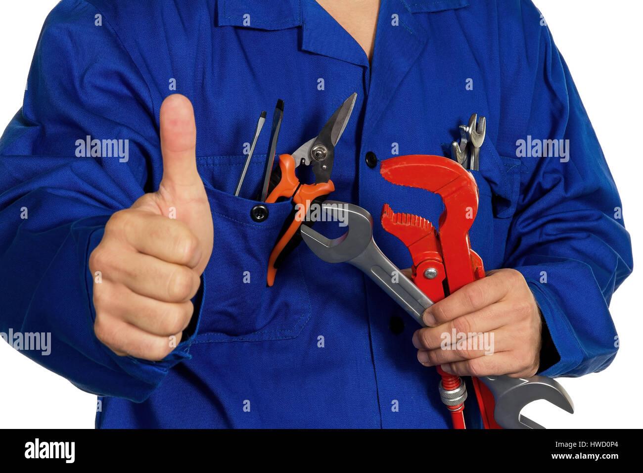 A worker in an industrial concern (craftsman) with tools in the hand, Ein Arbeiter in einem Gewerbebetrieb ( Handwerker Stock Photo