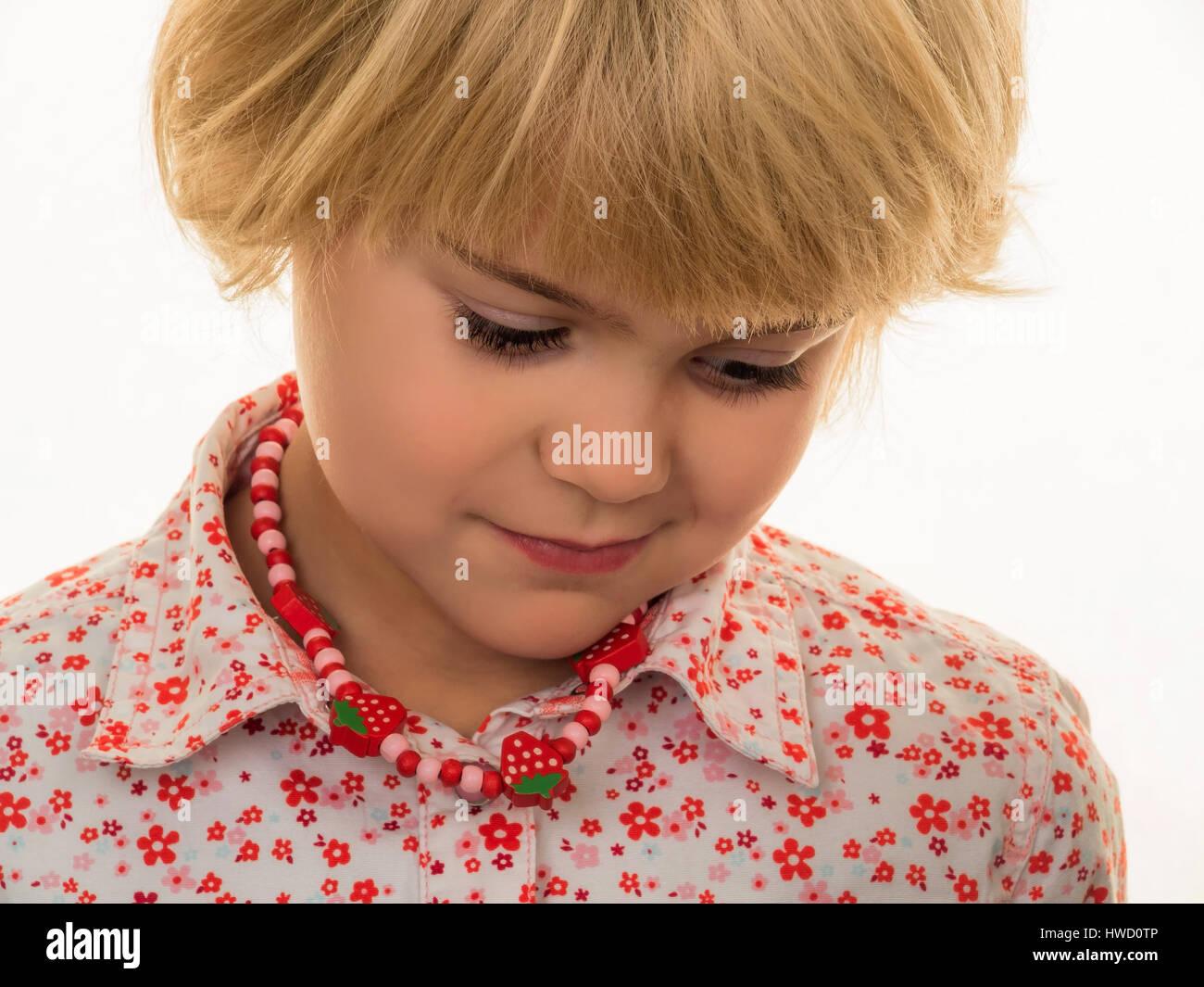 A small girl looks pensive., Ein kleines M‰dchen wirkt nachdenklich. Stock Photo