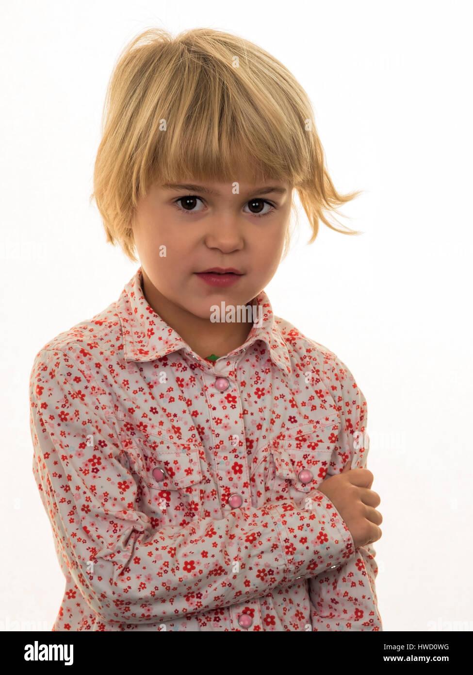 A small girl with a pensive expression, Ein kleines Mädchen mit einem nachdenklichen Gesichtsausdruck Stock Photo