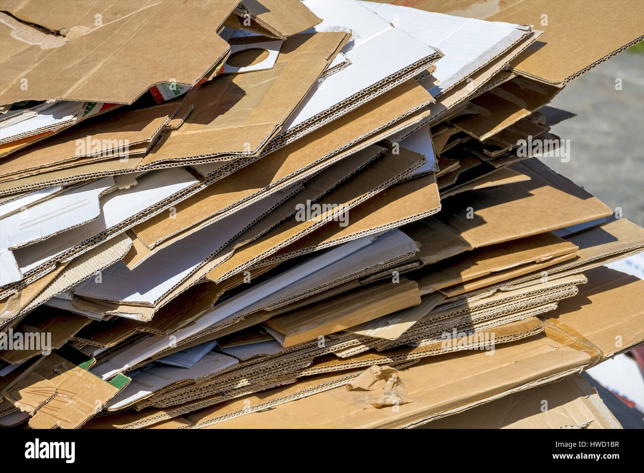 Cardboards wait for the collection by the garbage disposal. Recycling of waste paper., Kartons warten auf die Abholung Stock Photo