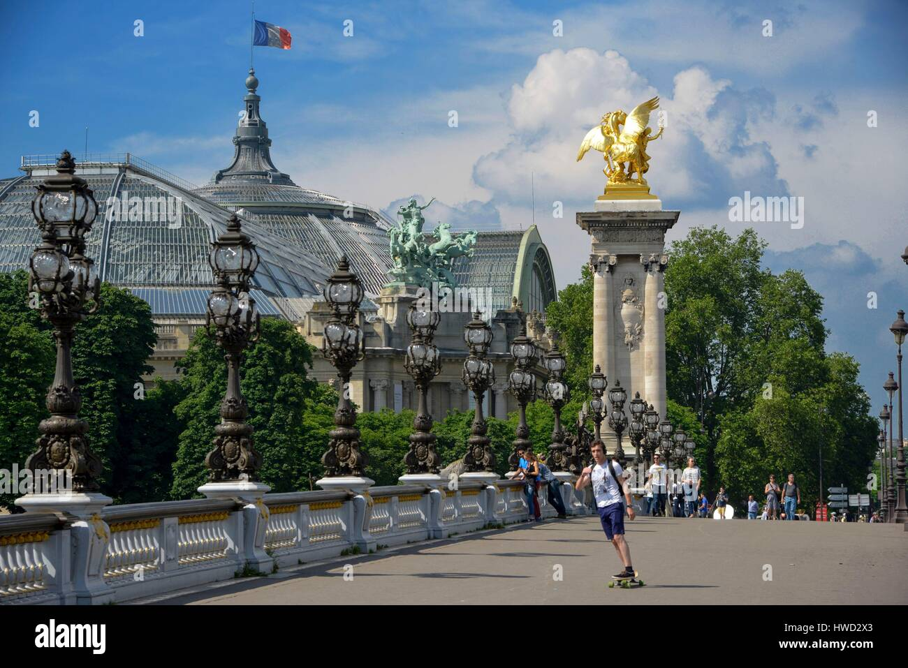 France, Paris, area listed as World Heritage by UNESCO, Alexandre III Bridge, young man doing skateboard on the - Stock Image