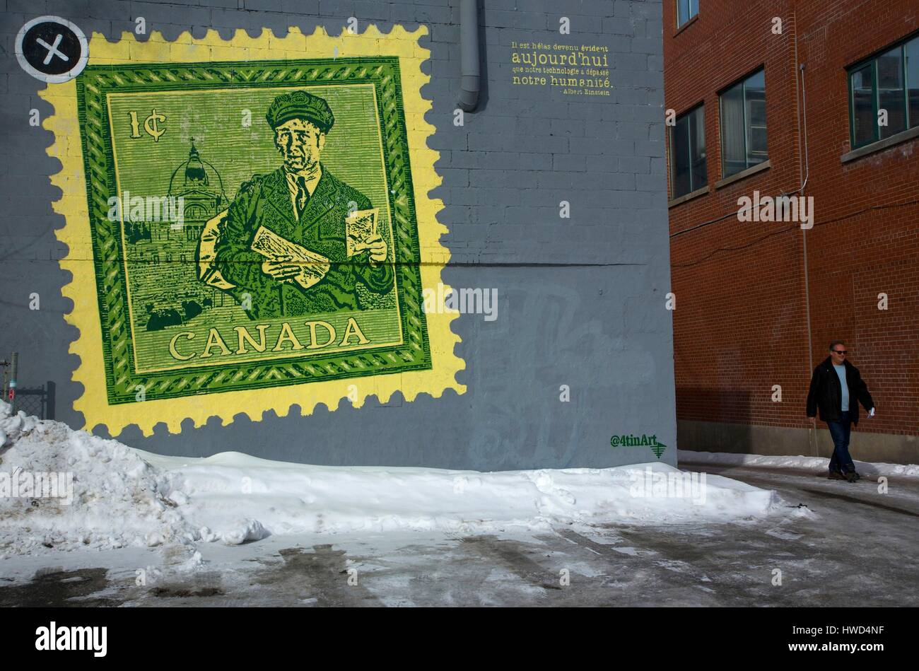 Canada, Quebec province, Montreal, Saint-Laurent boulevard, man passing in front of a mural representing a canadian - Stock Image