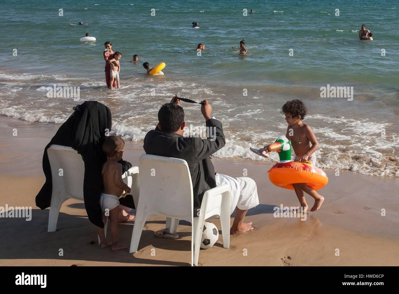 Yemen, Aden, couple bathing children during AId El Kebir - Stock Image