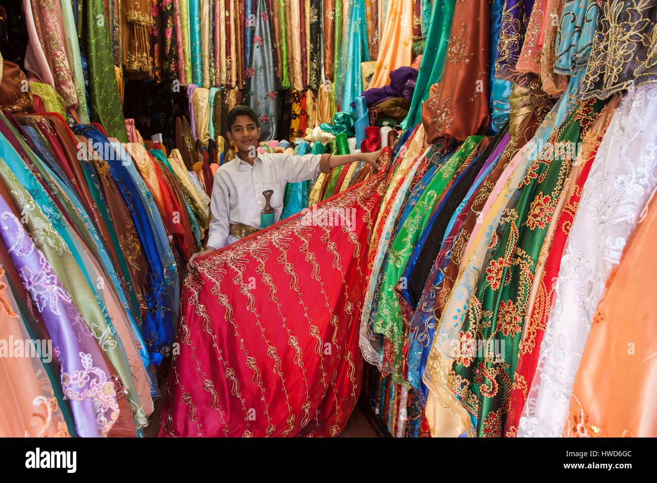 Yemen, fabrics of all colors are on sale in the souk of Sanaa, women in chador wear in the private very colorful - Stock Image