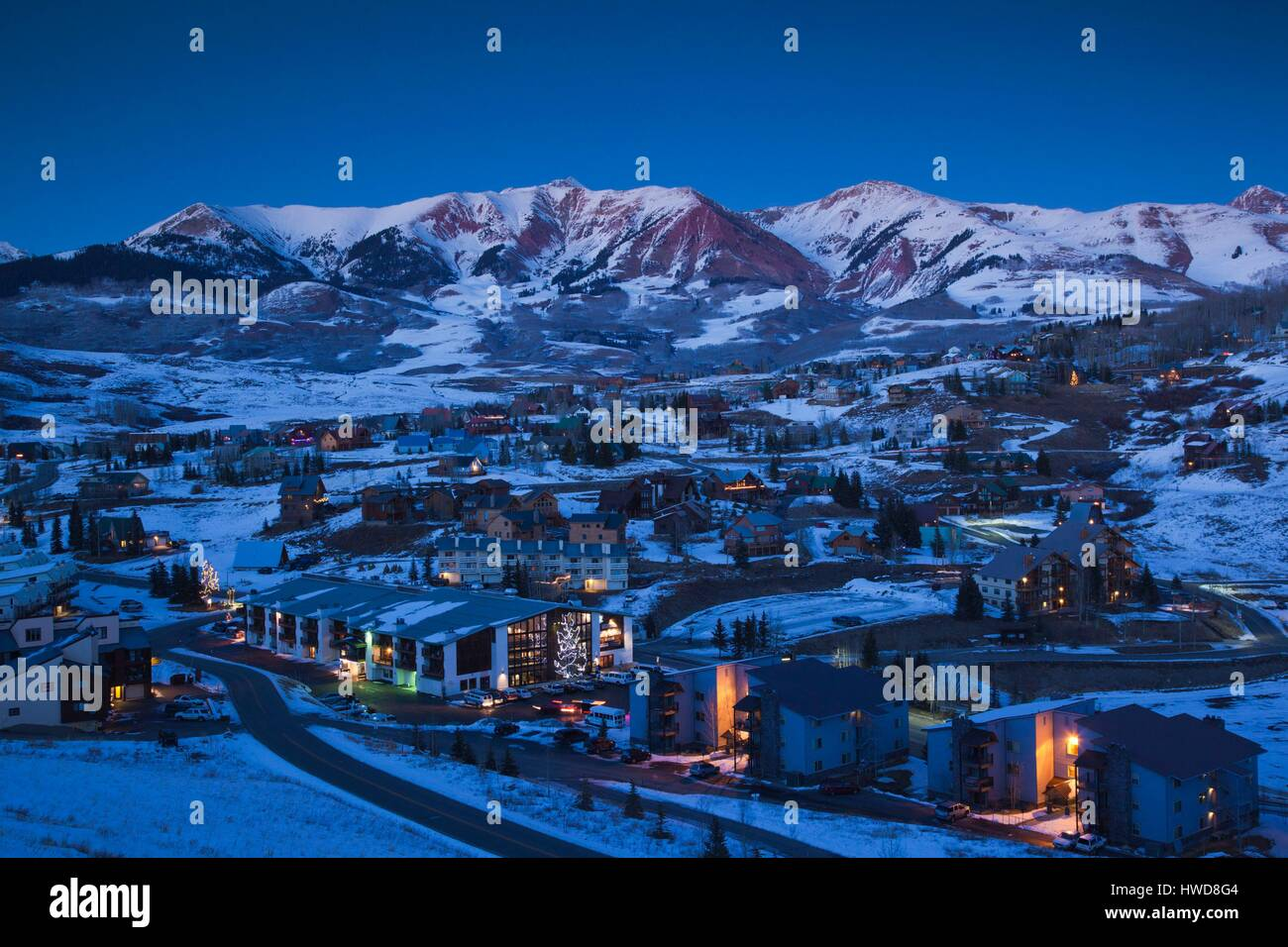 United States, Colorado, Crested Butte, Mount Crested Butte Ski Village, elevated view, winter, dusk - Stock Image