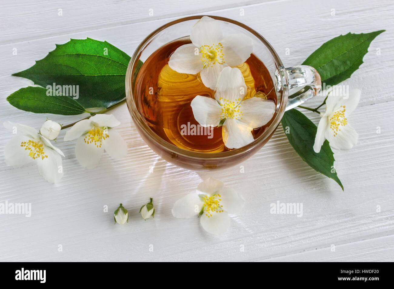 Jasmine Tea And Jasmine Flowers On Wooden Old Background Stock Photo