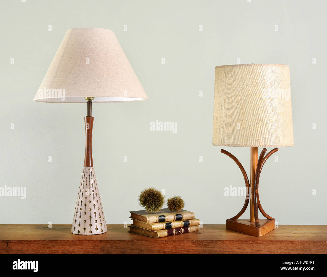 Vintage lamp shades stock photos vintage lamp shades stock images books on wooden shelf between two vintage house lights with classic style lamp shades stock aloadofball Choice Image