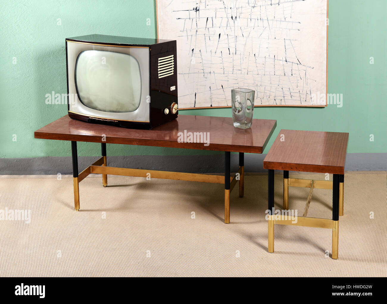 Retro Living Room With Furniture Still Life   Old Television On Table With  Glass Vase In Painted Green Room With Abstract Wall Art And Beige Carpet