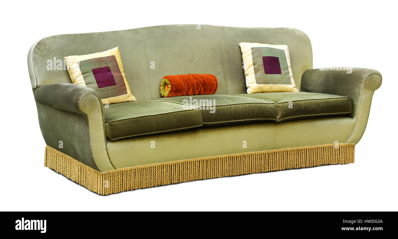 Three Seater Green Velvet Upholstered Couch Or Sofa With Long Floor Fringe  And Geometric Square Cushions Isolated On White