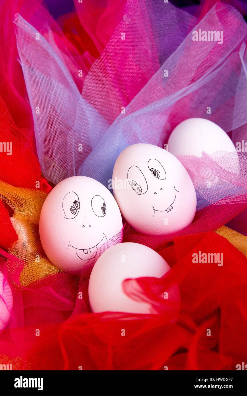 Easter eggs with funny faces on colorful and bright background