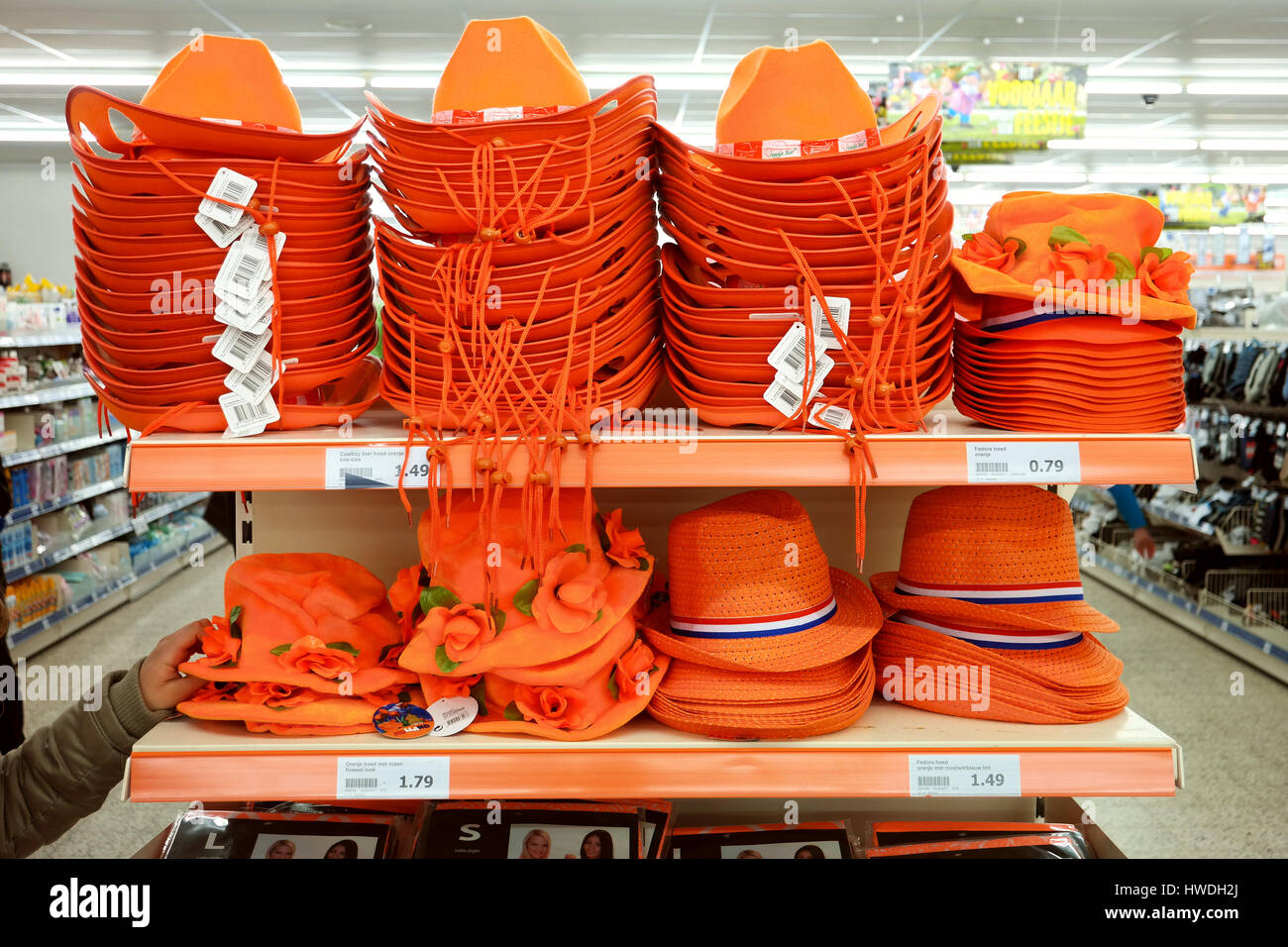 Display with headgear for a orange outfit to celebrate Dutch kings day. - Stock Image
