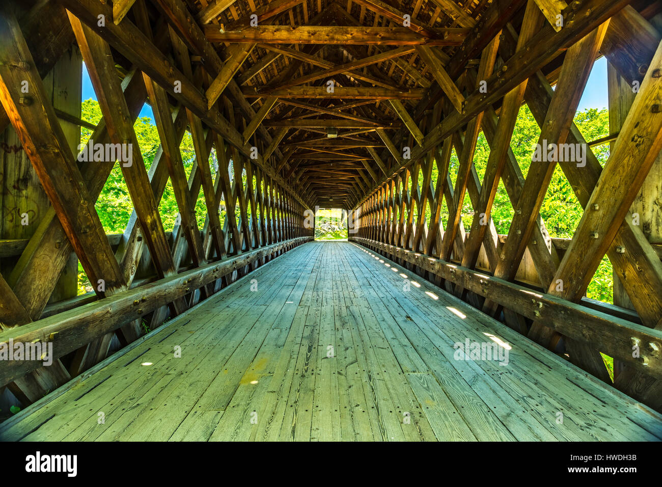 The Henniker Covered Bridge is a covered pedestrian footbridge serving New England College across the Contoocook - Stock Image
