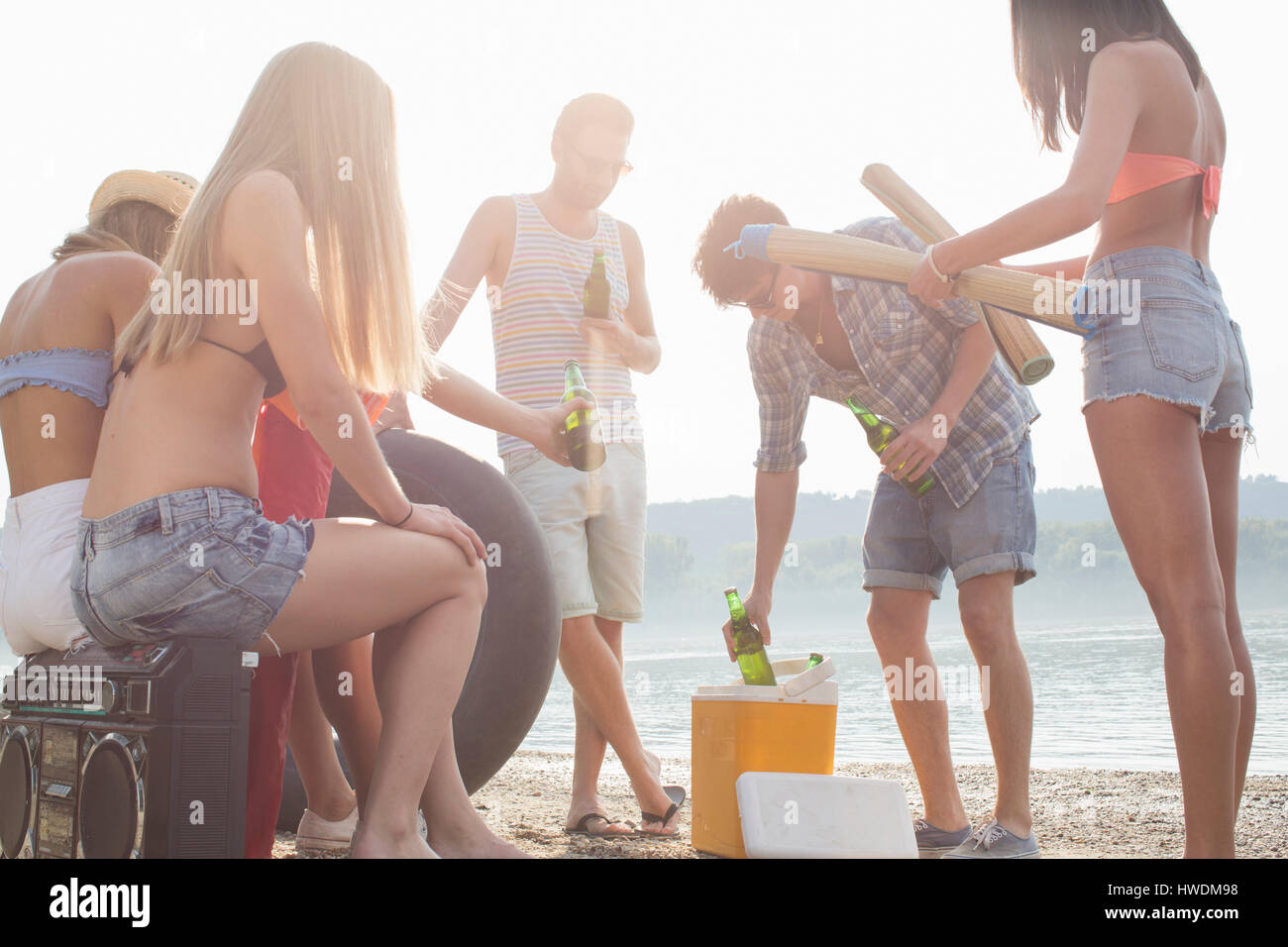 Group of friends enjoying beach party - Stock Image